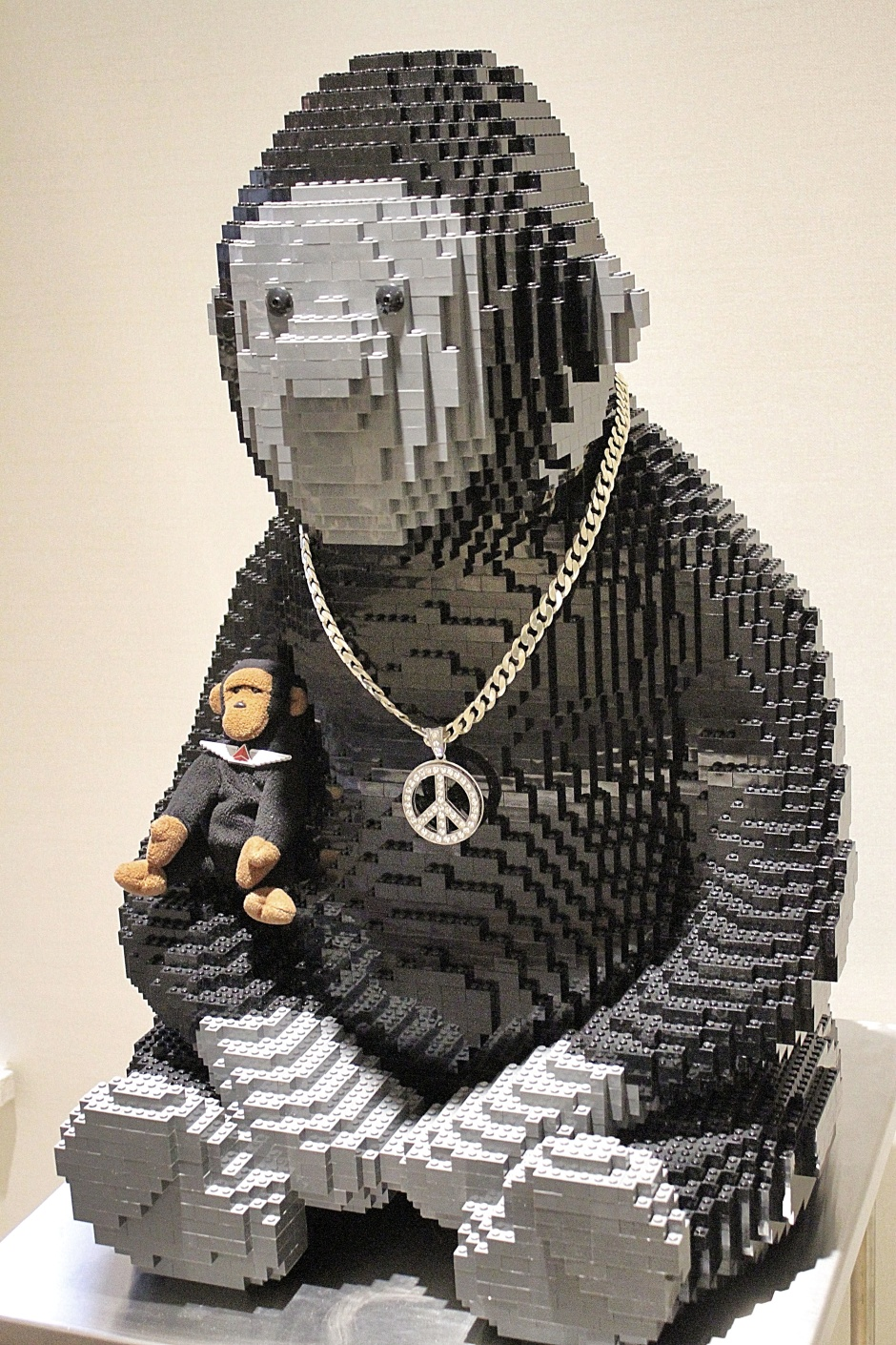 A big monkey made of Legos with a bling necklace greets Kongo in the dining room