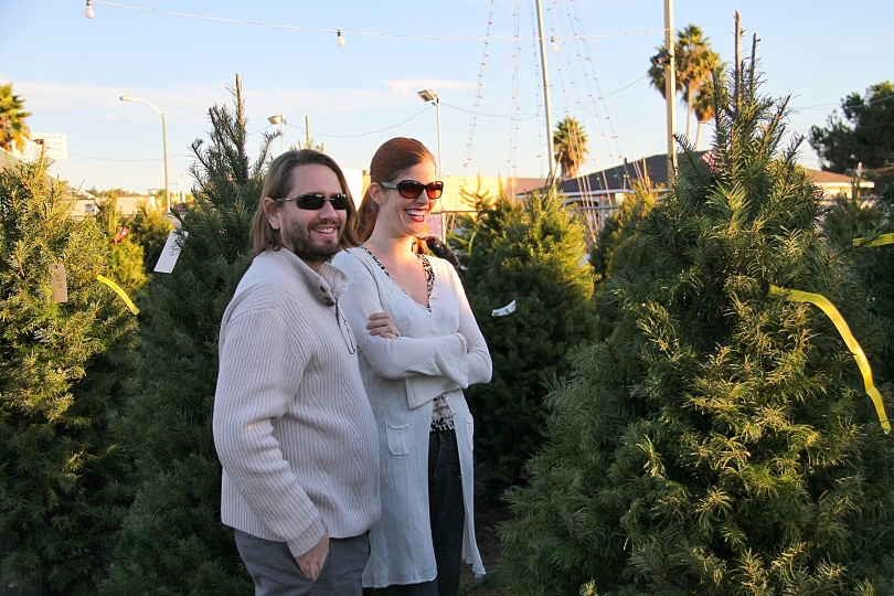 Patrick and Emily survey the choices at the Christmas Tree lot