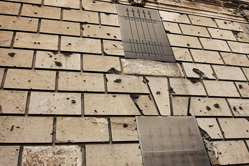 A wall pockmarked by bullet holes from a WWII battle in Budapest, Hungary