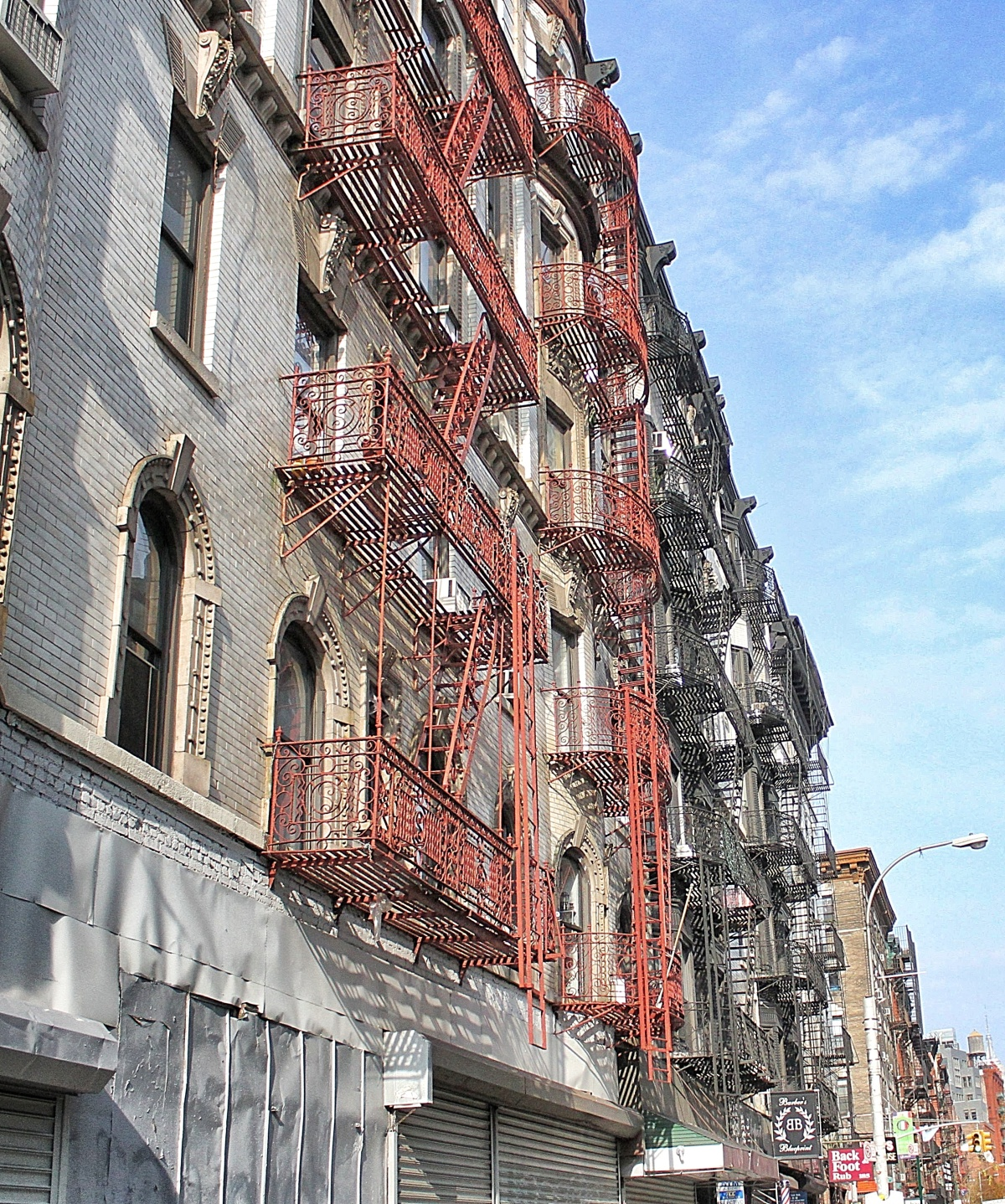 Fire escapes on the outside walls of 19th century builds in Little Italy, New York City