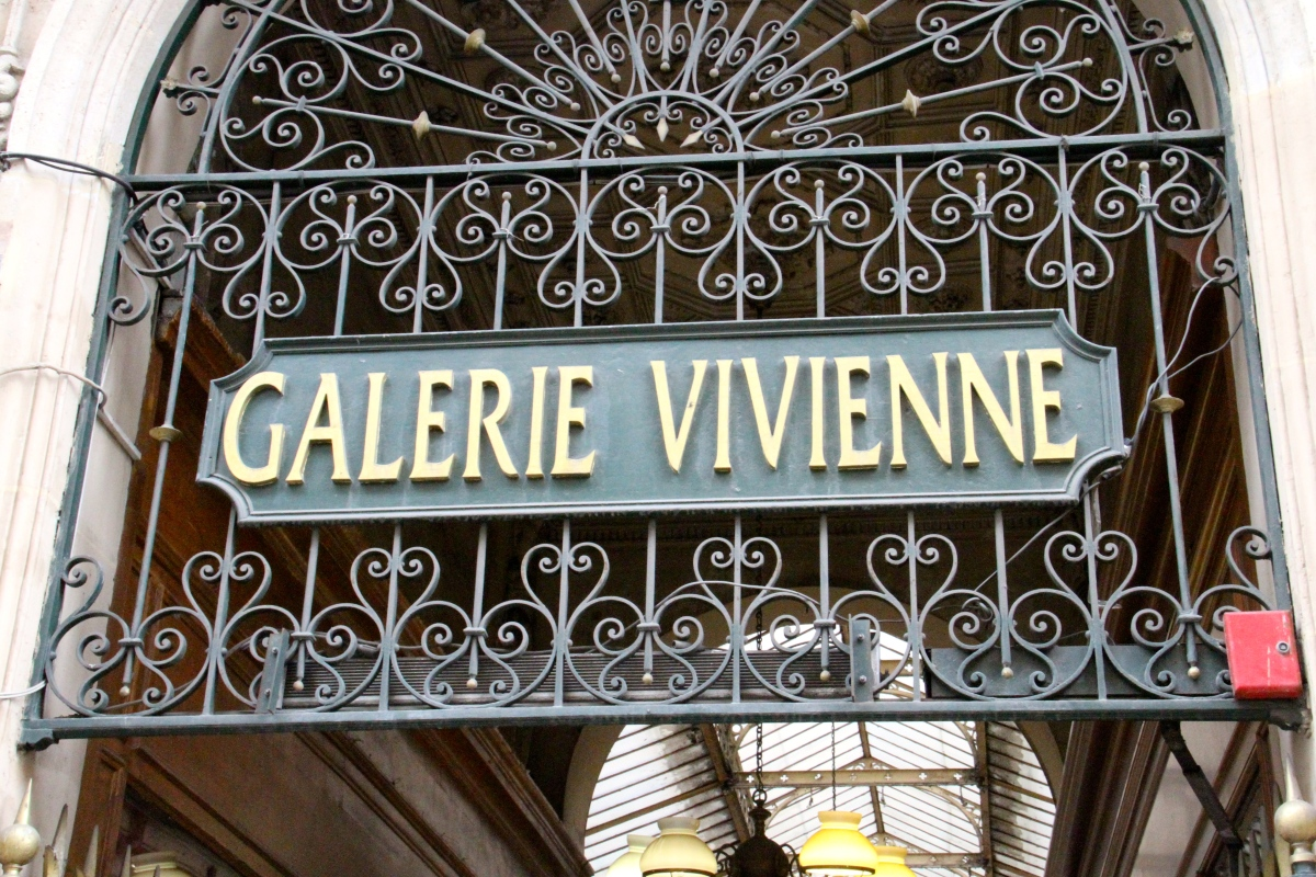 Galerie Vivenne is a great place to have a glass of wine and that is exactly what  the monkey had inside!