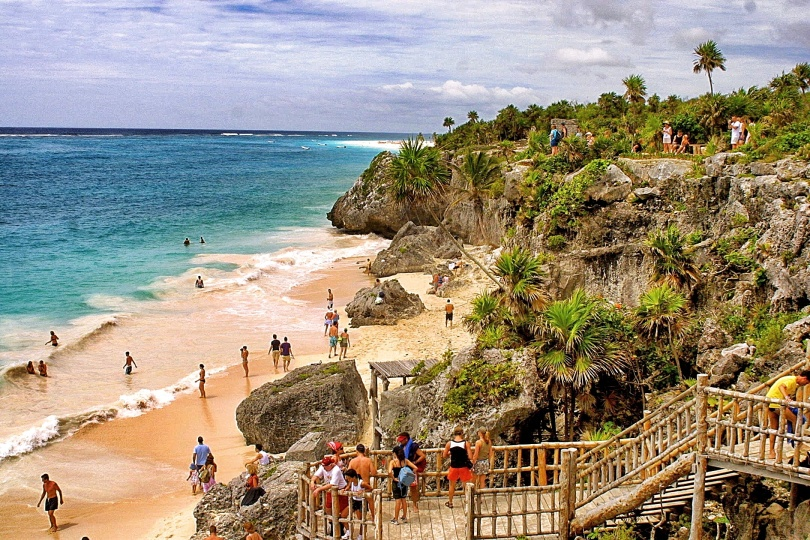 One of the most beautiful beaches in the world is below the ruins at Tulum, Mexico on the Mexican Riviera.