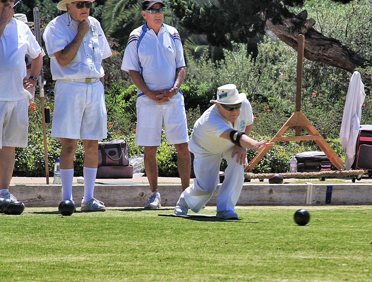Lawn bowlers exhibit a variety of styles in releasing the bowl.