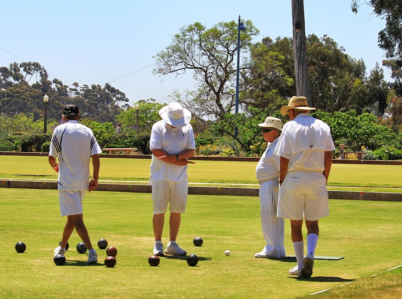Counting up the score afterwards.  Another riveting aspect of lawn bowling.