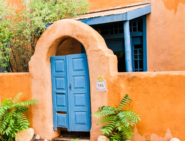 Blue trim against adobe is a popular theme in Santa Fe.