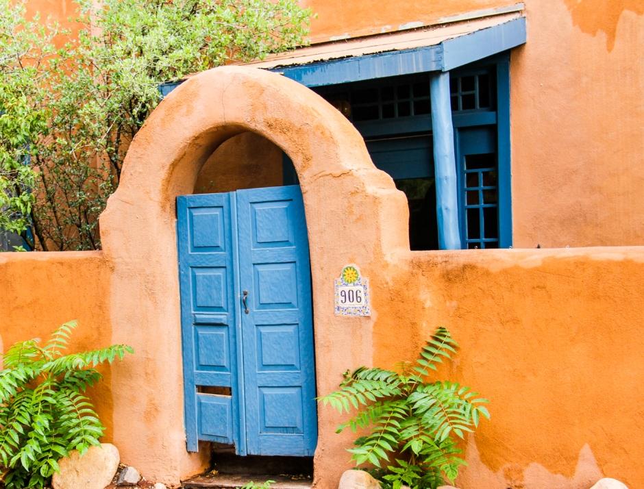 Blue trim against adobe is a popular theme in Santa Fe.