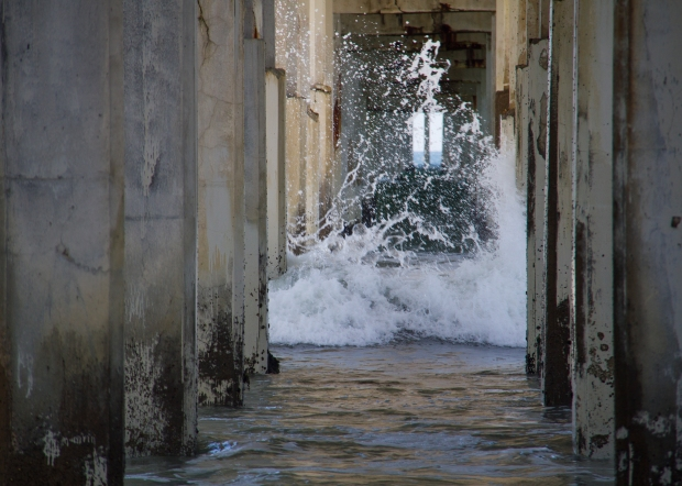 Surf crashing under the pier