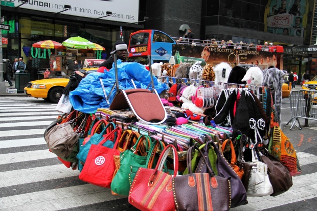 Colorful bags soon to be for sale on a NYC sidewalk