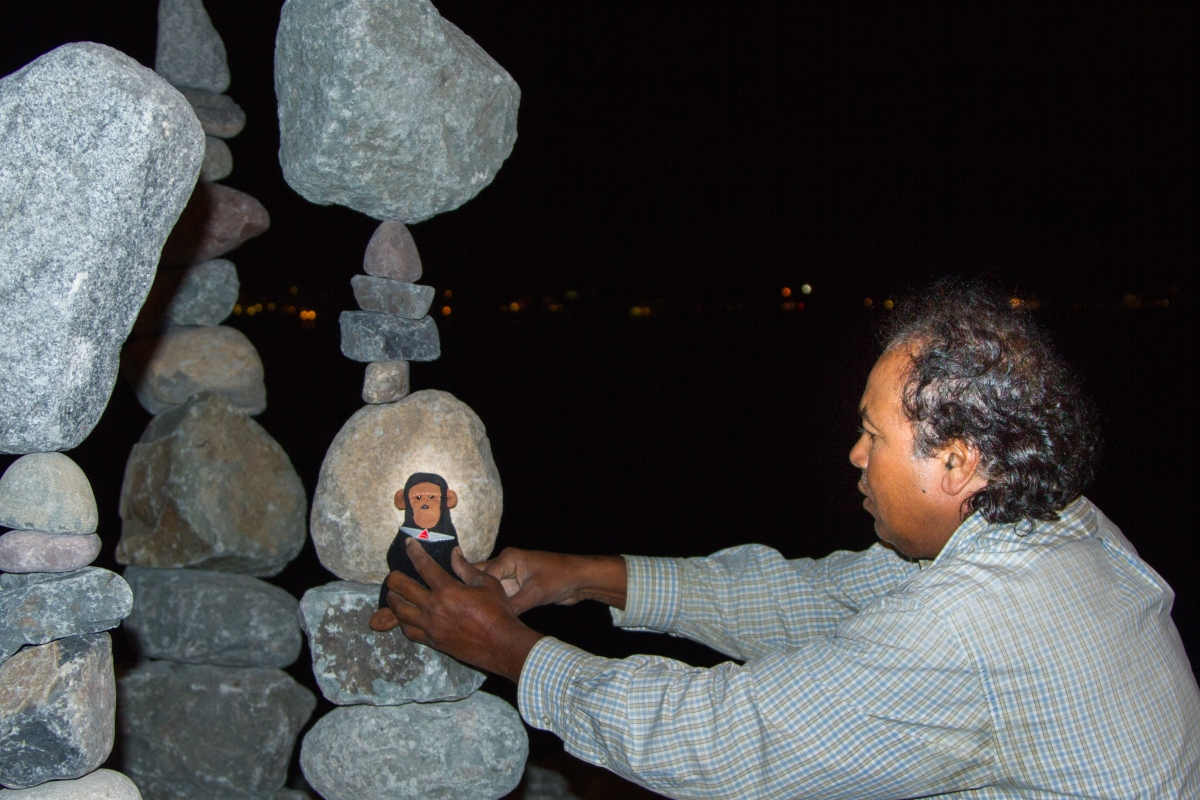 Rabindra carefully places Kongo on a rock pile, being careful not to disturb the fragile balance of the columns