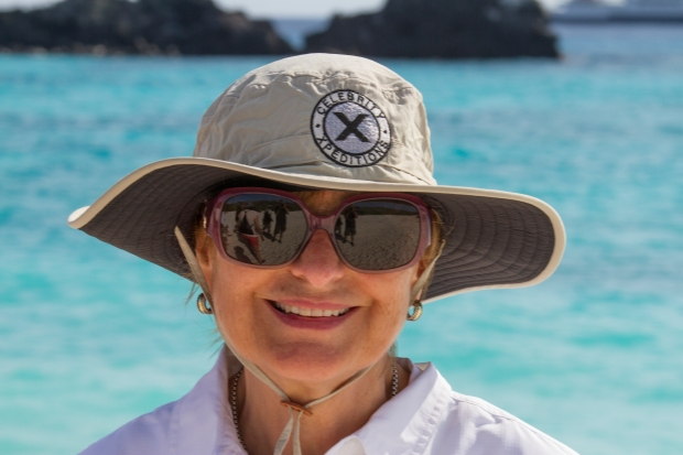 Hats with big brims and sunglasses are essential on land excursus.  Light colored clothing reflects the hot equatorial sun and is less attractive to the occasional wasp or bee colonies that inhabit some of the islands.