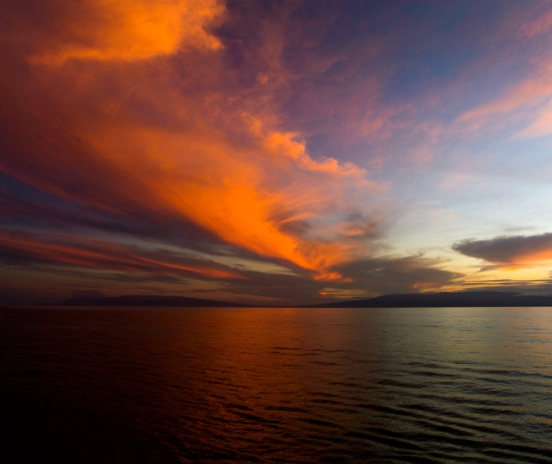 Kongo captured this sunrise with a steady hand, a high ISO setting, and made a panorama.  Tripods don't work so well on ships.