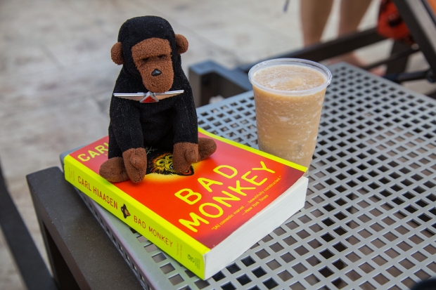 Kongo's poolside reading material along with his favorite Cancun drink:  The Banana Monkey.  (What else?)
